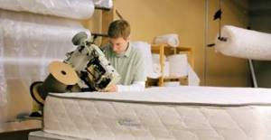 This is Tim, owner of My Green Mattress, working on making one of his amazing organic mattresses!